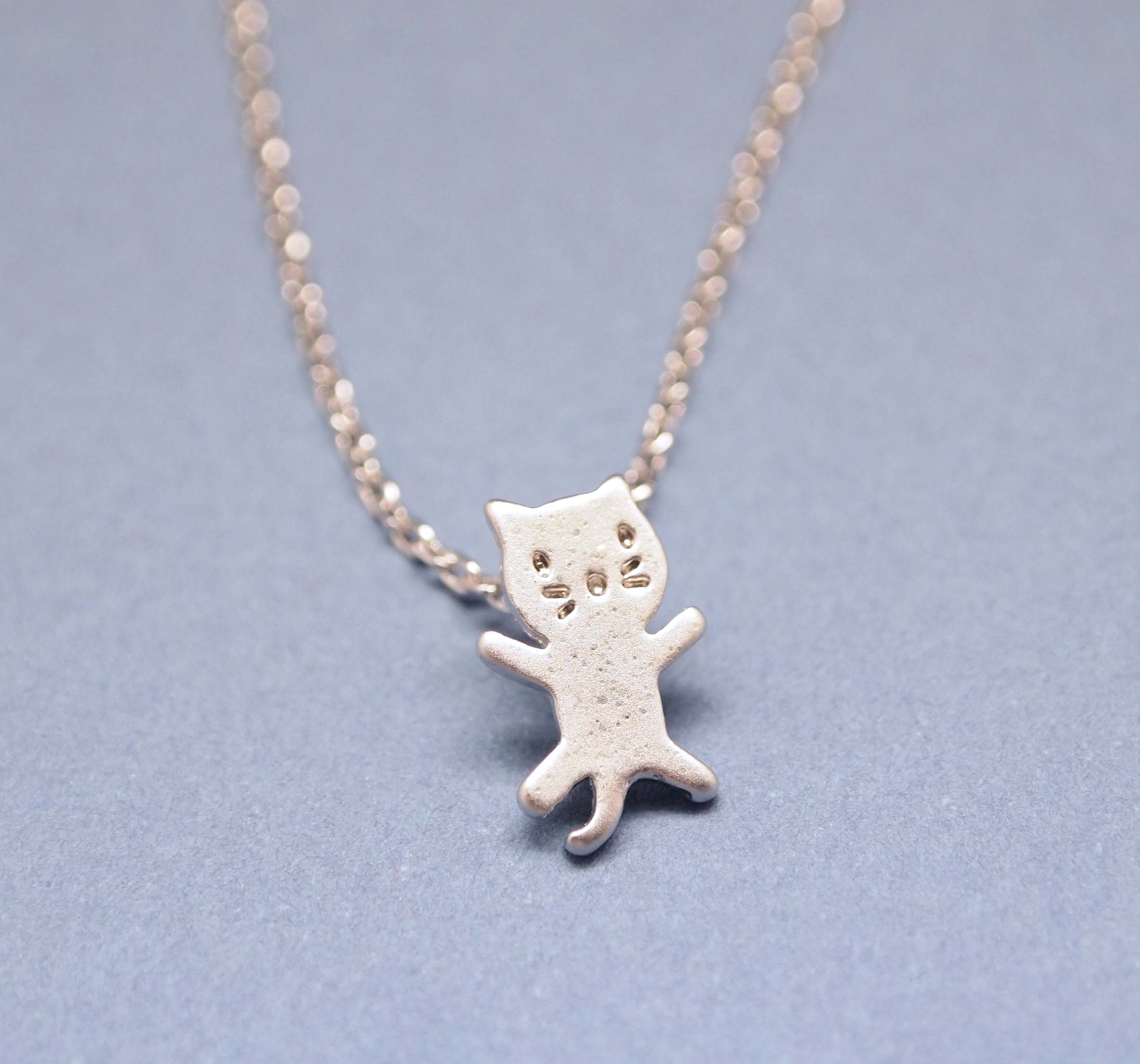 tiny cat pendant necklace in silver on luulla